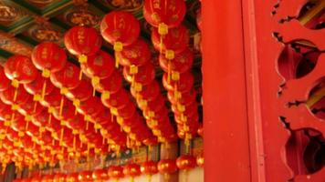 Chinese paper lanterns behind the door on Chinese new year celebration