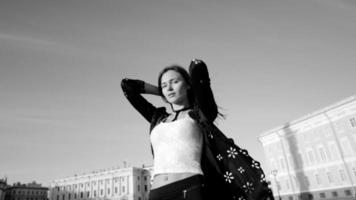 Black and white video of a model in stylish clothes