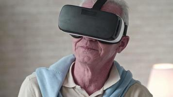 Old Man in VR Goggles Touching Something in Air