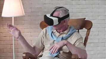 Elderly Man in Rocking Chair Wearing VR Headset