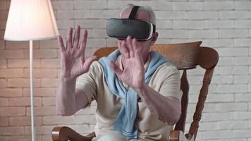 Elderly Man in VR Goggles Touching Air