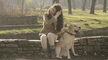 Girl and her dog playing in a park video