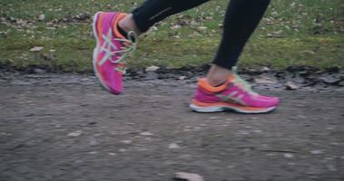 Woman wearing bright pink running shoes