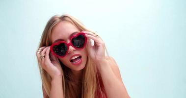 Young woman wearing big modern sunglasses video