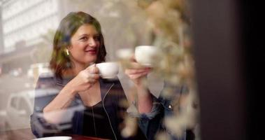 Man and Woman Sipping Their Coffee in Cafe video