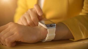 Woman's hand touching the screen of a smart watch video