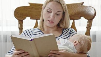 Blond Mother Reading to Sleeping Baby video