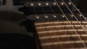 Camera slowly sliding over electric guitar video