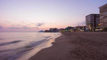 Spagna Benidorm tramonto mare città panorama 4K lasso di tempo