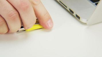 Unlocking and Locking a Yellow Pen Drive video