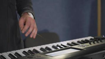 man playing on the synthesizer with touch screen video