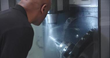 Male Engineer Operating CNC Machinery On Factory Floor video