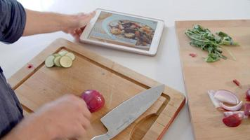 Man Follows Recipe On Digital Tablet In Kitchen Shot On R3D video