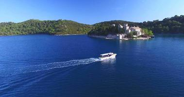 Aerial view of tourist boat arriving at St. Mary island on island of Mljet, Croatia video