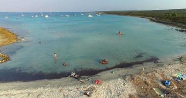 Tourists enjoying on beautiful Slatinica beach at Olib Island, Croatia