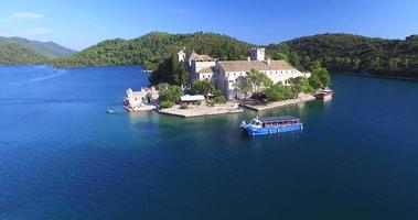 Aerial view of catamaran with tourists on Mljet island, Croatia video
