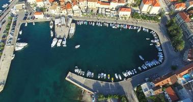 Aerial view of boat entering Supetar marina on Island of Brac