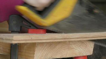 sawing of wooden plank video