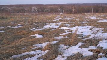 Rural Field with Snow Patches
