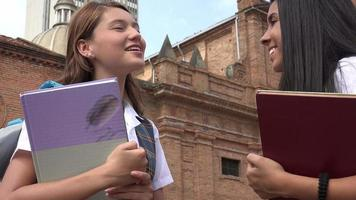 Female Students Holding Textbooks video
