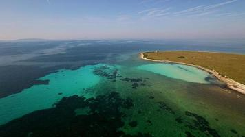 Aerial - Decay of algae during algal blooms at small sea island