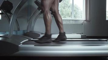 Male legs fast walking on treadmill