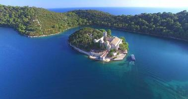 Aerial view of catamaran arriving at St. Mary island on Mljet Island, Croatia video