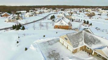 Winter flyover of wealthy suburban neighborhood homes