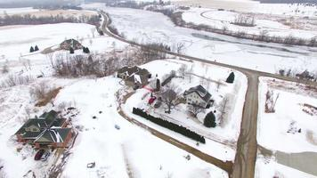 Aerial tour over snowy rural Wisconsin homes in Winter video