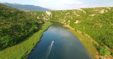 Aerial view of a motorboat speeding on Zrmanja river, Croatia