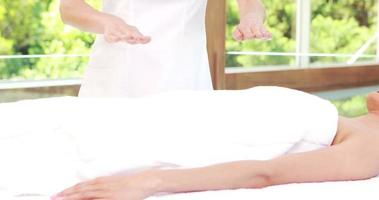 Relaxed brunette receiving reiki video