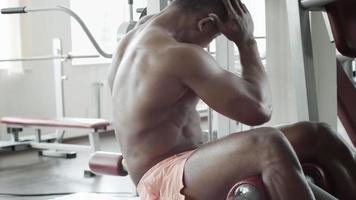 Athletic man execute abdominal exercises