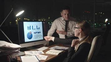 Business People Analyzing Statistics at Night