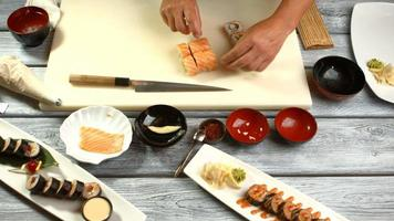 Cooking board with sushi rolls