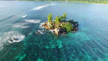 Aerial view of small rocky island on Mahe Island, Seychelles. video