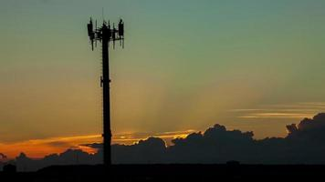 Communication tower with a sunset timelapse video