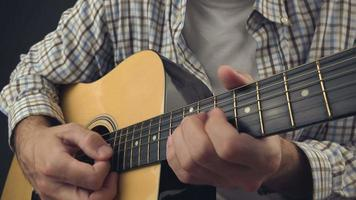 Man playing rock tune on acoustic guitar video