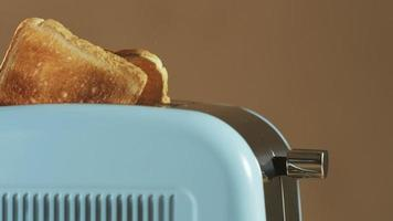 Two Loaves of Bread Jumping Out of an Electric Toaster video