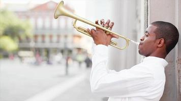 Black man plays a trumpet in the street video