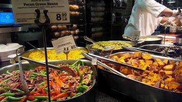 Prepared food in display at the supermarket 4k video