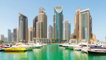 Uae sunny day dubai marina city gulf yacht dock panorama 4k time lapse
