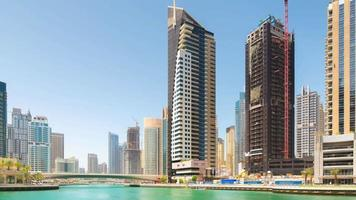 Uae dubai marina sunny day construction apartment building panorama 4k time lapse