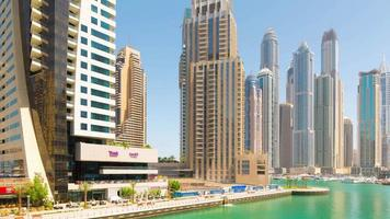 Uae sunny day dubai marina tourist walking bay panorama 4k time lapse
