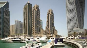 Uae sunny day dubai marina private dock bay walk 4k time lapse