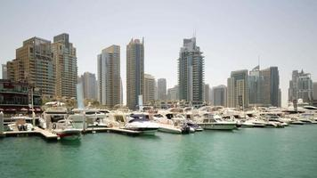 Uae dubai marina sunny day yach t private dock 4k time lapse