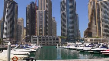 uae day light panorama yacht dock dubai marina 4k video