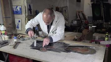 a master glazier rebuilt stained glass