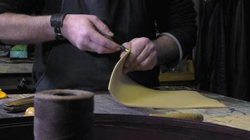 leather goods craftsman at work in his workshop video
