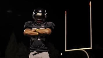Portrait of a football player on a field crossing his arms video