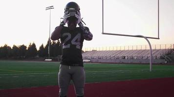 Portrait of a football player putting on his helmet video